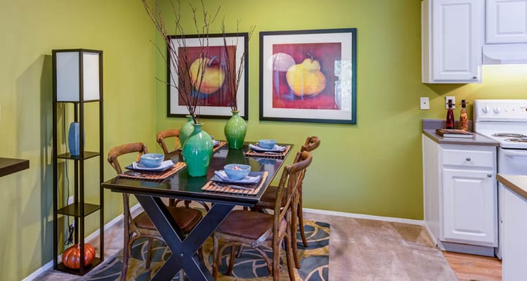 Well-decorated dining room in model home at Walden Pond Apartments in Everett, WA