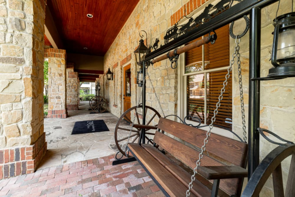 Antique swing bench outside main entrance of Marquis at Bellaire Ranch in Fort Worth, Texas