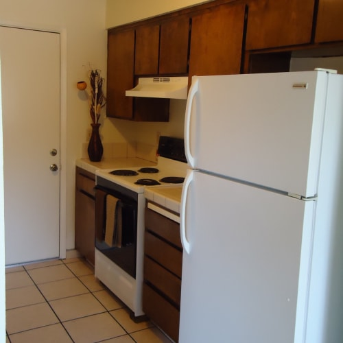 A model home's kitchen at Olympus Court Apartments in Bakersfield, California