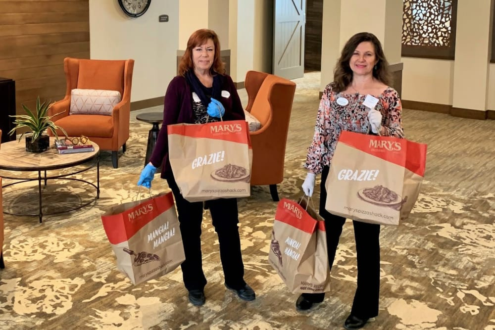 Staff delivering soup to residents