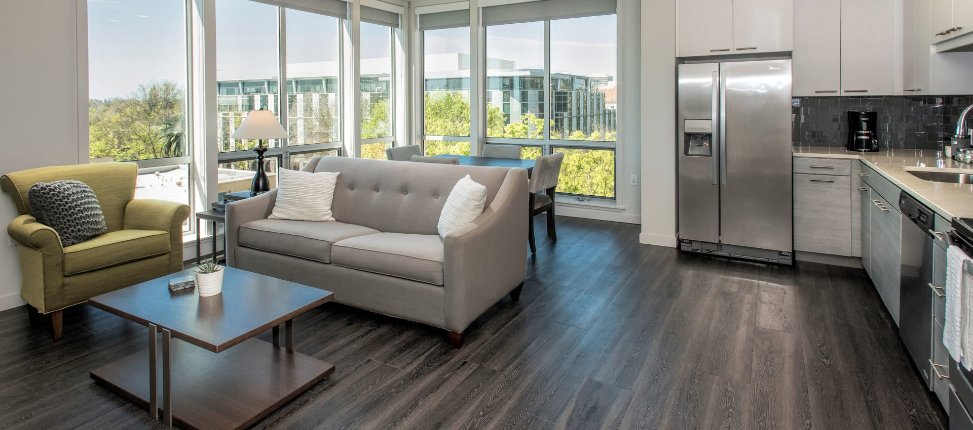 Spacious living room with hardwood floors at EVIVA Midtown in Sacramento, California
