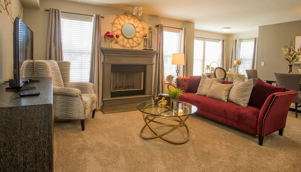 Living room with a fireplace at Tuscany Ranch in Waco, Texas