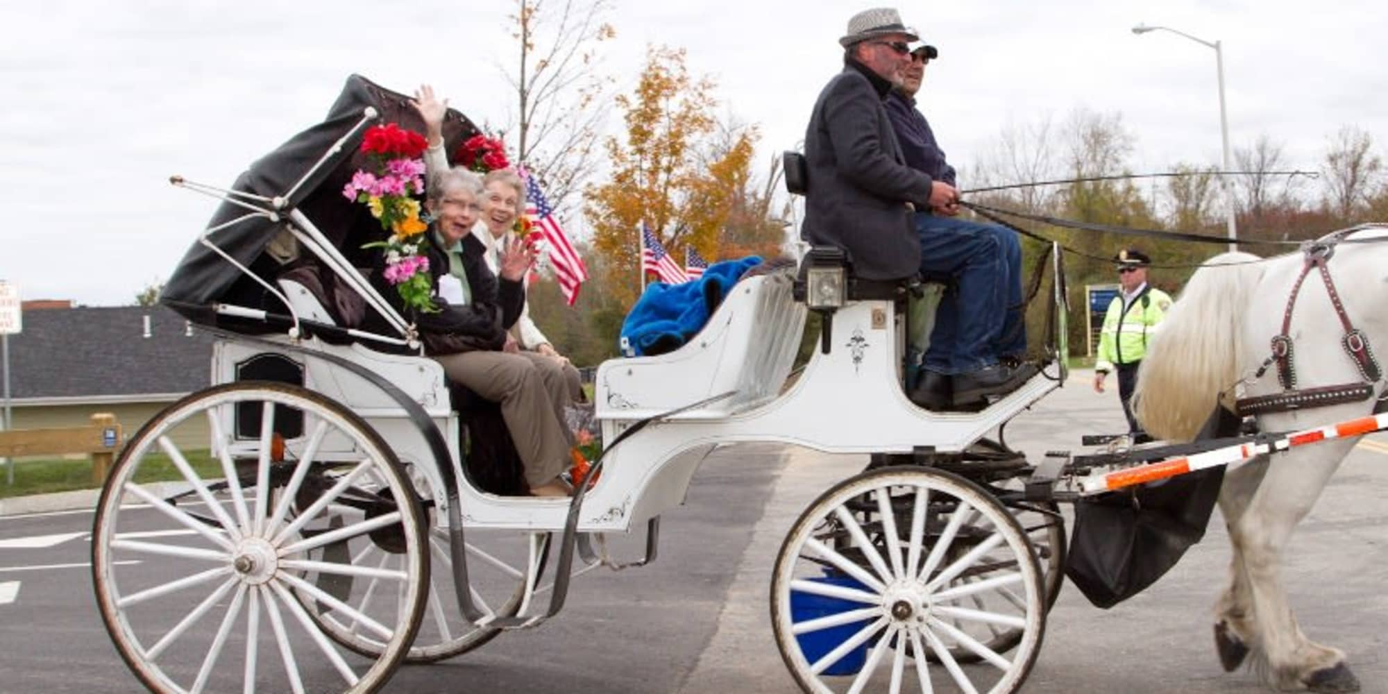 Residents from Fairview Estates Gracious Retirement Living in Hopkinton, Massachusetts in a horse drawn carriage