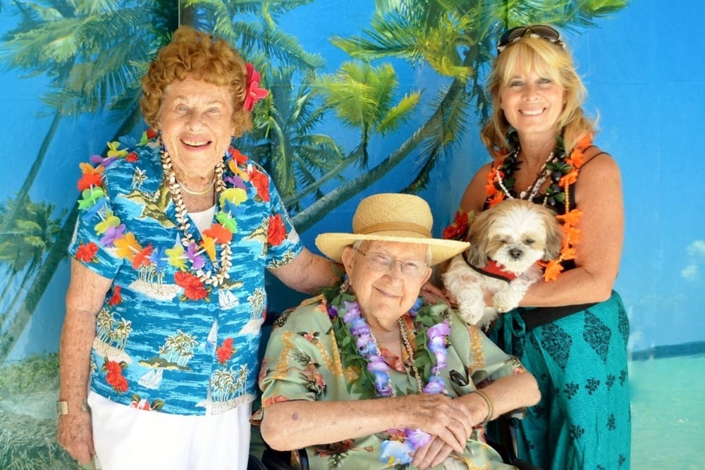 Enjoying the Hawaiian party at Merrill Gardens at Santa Maria in Santa Maria, California.