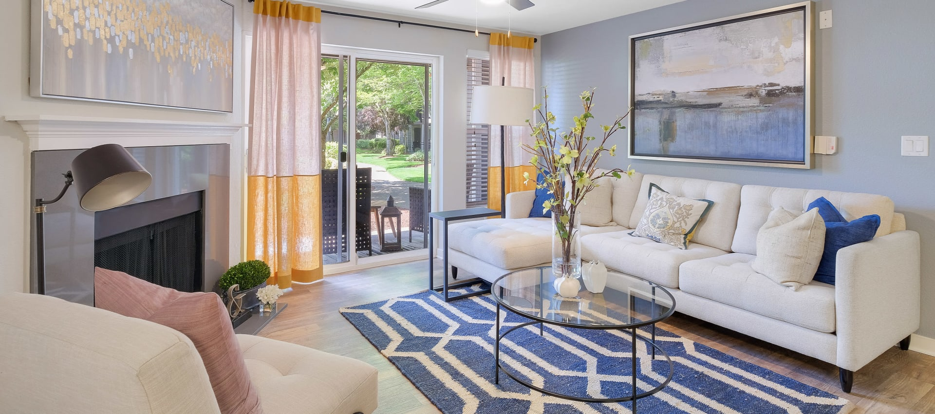 Naturally well lit living room at Centro Apartment Homes in Hillsboro, Oregon