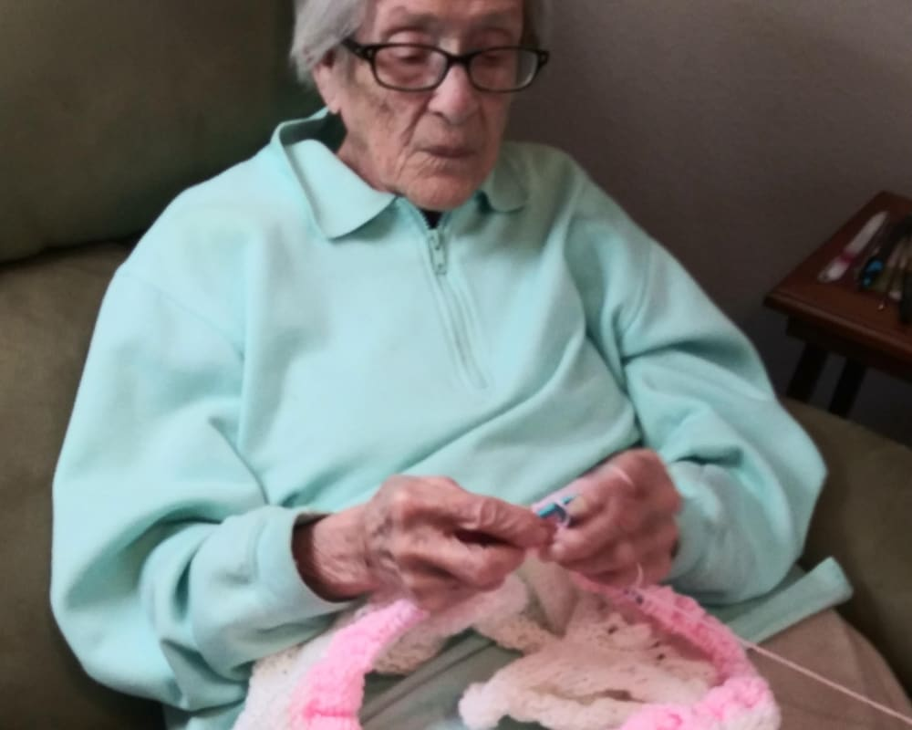 A resident knits a blanket at Arlington Place of Red Oak in Red Oak, Iowa