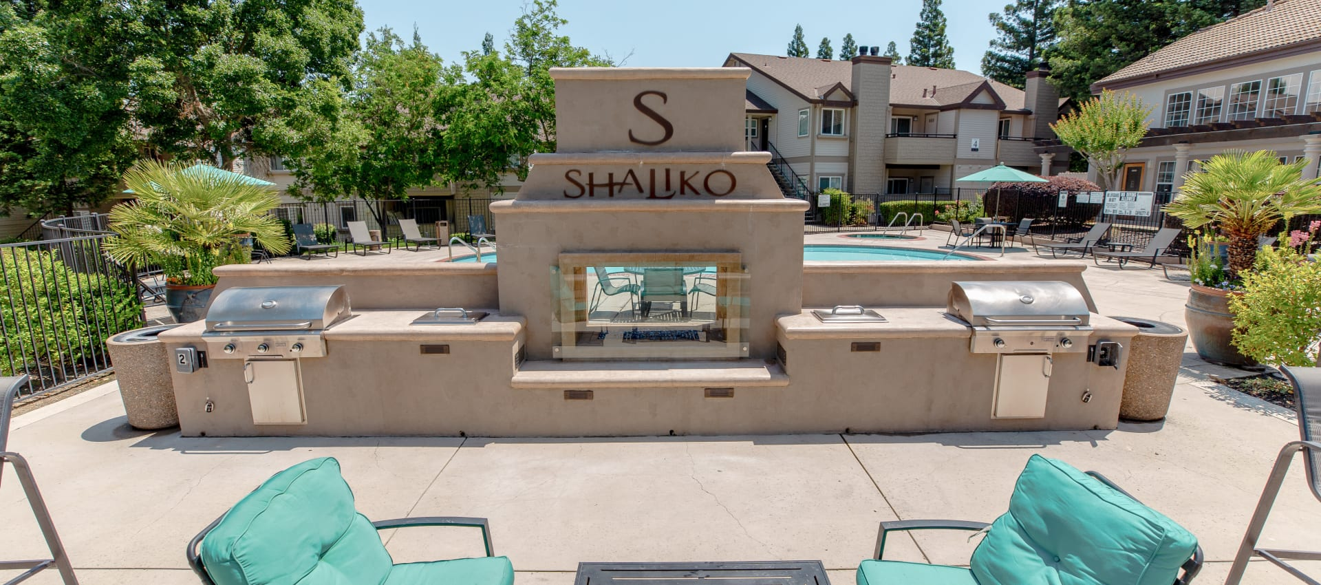 Outdoor fireplace and grills at Shaliko in Rocklin, California.