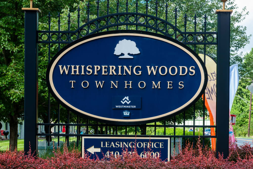 Apartments sign at Whispering Woods