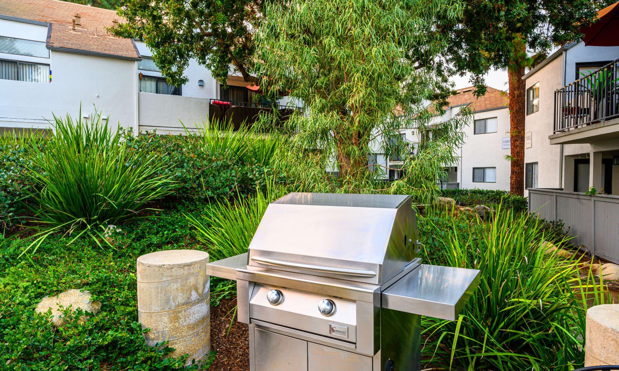 Barbecue area with a gas grill at Sendero Huntington Beach in Huntington Beach, California