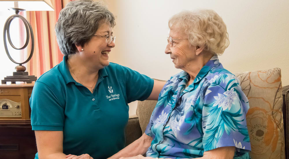 Resident with caregiver at The Springs at Wilsonville in Wilsonville, Oregon