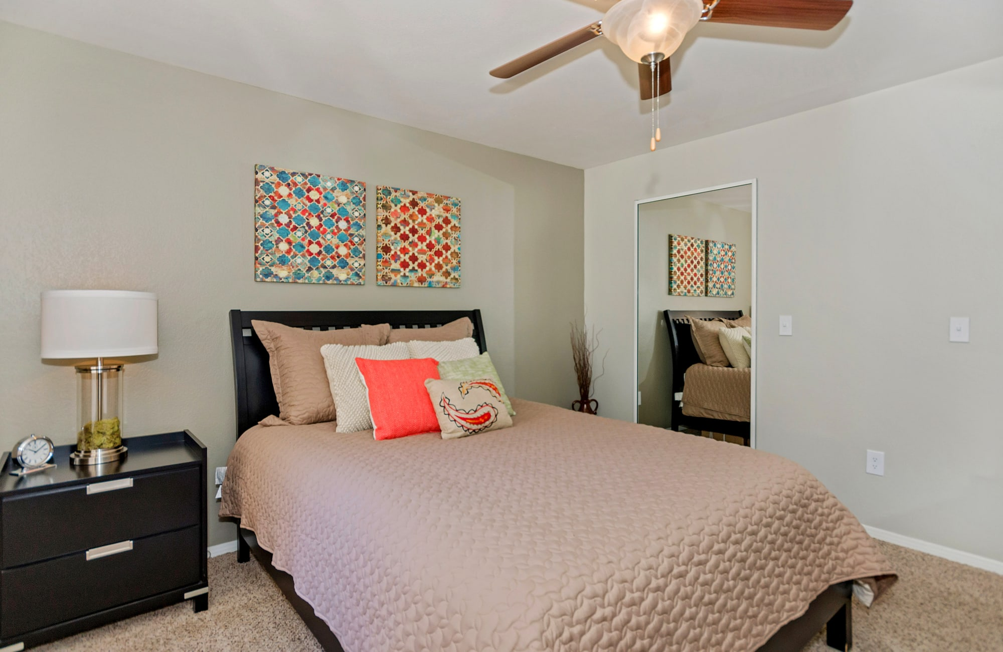 Guest bedroom with ceiling fan in model home at The Boulevard in Phoenix, Arizona
