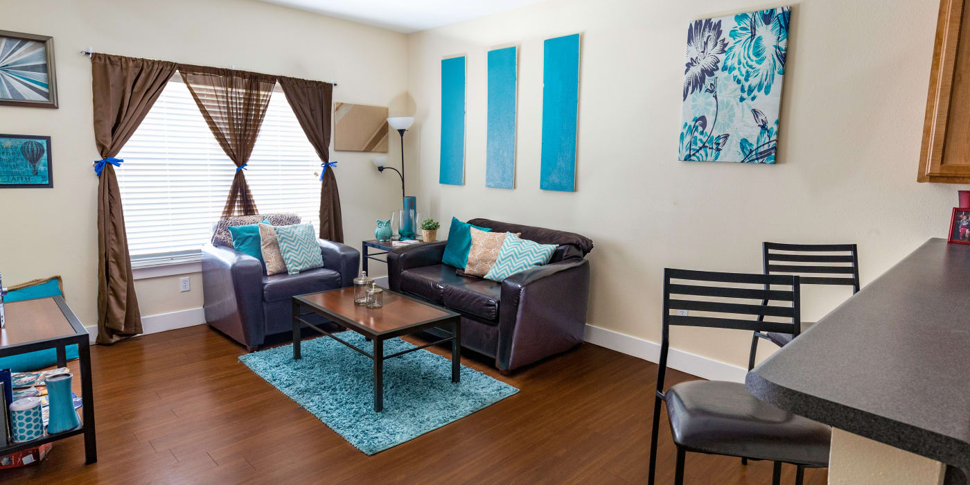 A large living room for four roommates at Beacon Springfield in Springfield, Missouri
