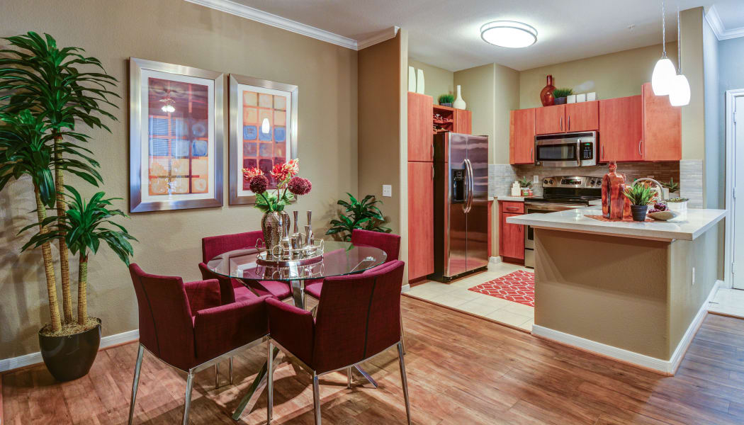 Gourmet-inspired kitchen and spacious dining room at San Paloma Apartments in Houston, Texas