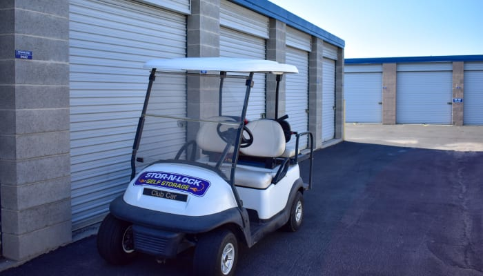 A golf cart in front of exterior storage units at STOR-N-LOCK Self Storage in Sandy, Utah