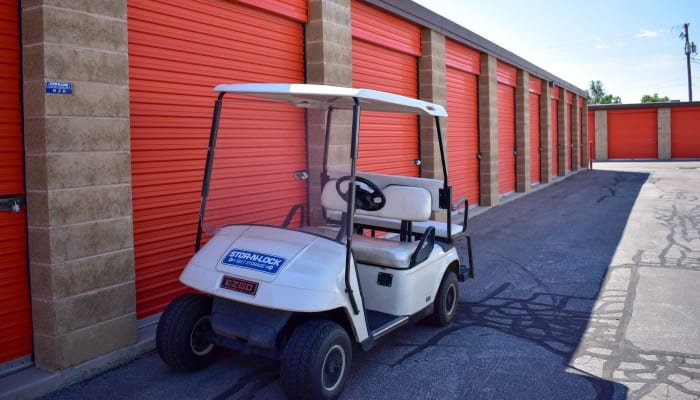 A golf cart in front of exterior storage units at STOR-N-LOCK Self Storage in Taylorsville, Utah