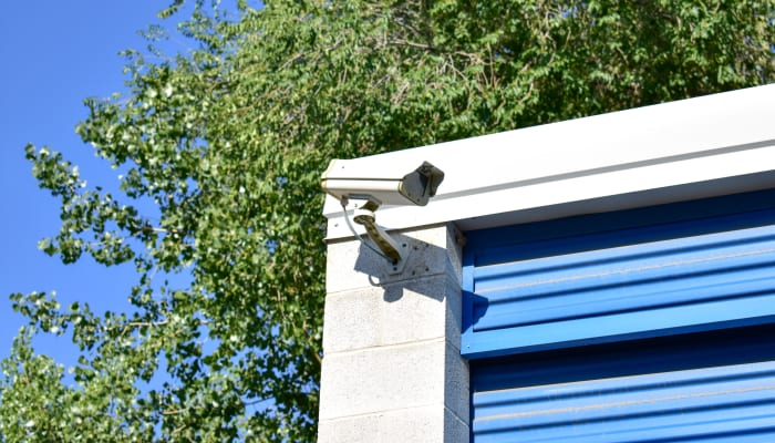 A security camera on the exterior of a storage unit at STOR-N-LOCK Self Storage in Cottonwood Heights, Utah