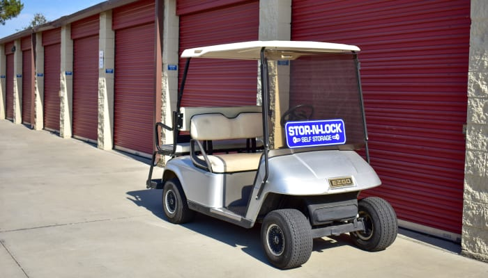 A golf cart in front of exterior storage units at STOR-N-LOCK Self Storage in Rancho Cucamonga, California