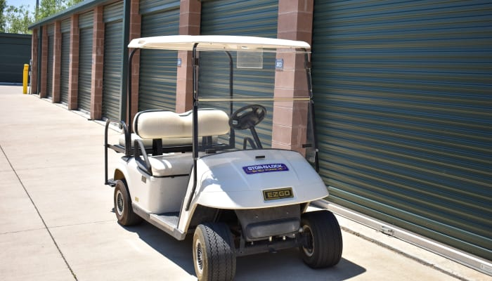 A golf cart in front of exterior storage units at STOR-N-LOCK Self Storage in Henderson, Colorado