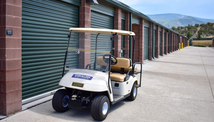 A golf cart in front of exterior storage units at STOR-N-LOCK Self Storage in Gypsum, Colorado