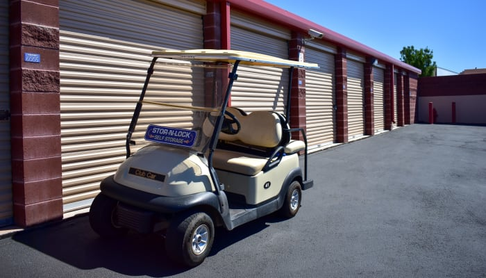 A golf cart in front of exterior storage units at STOR-N-LOCK Self Storage in Hurricane, Utah