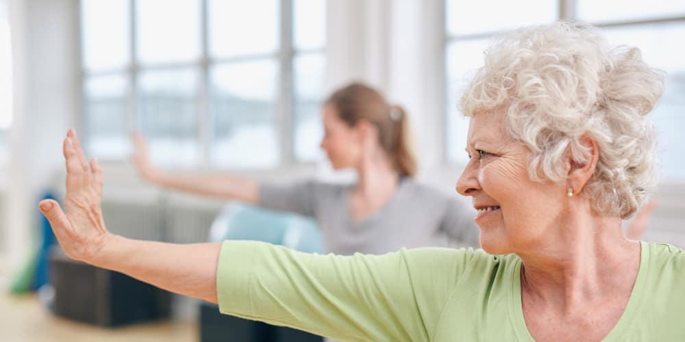 Seniors practicing yoga at The Commons at Elk Grove in Elk Grove, California
