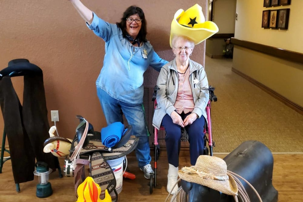 A resident and a staff member taking part in an event at Villas of Holly Brook Newton in Newton, Illinois
