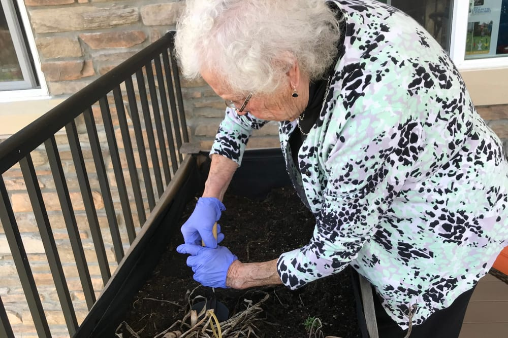 Resident enjoying time garden at Edencrest at Riverwoods in Des Moines, Iowa