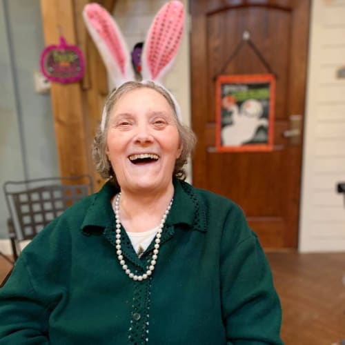 Resident Smiling while wearing bunny ears at Oxford Glen Memory Care at Owasso in Owasso, Oklahoma