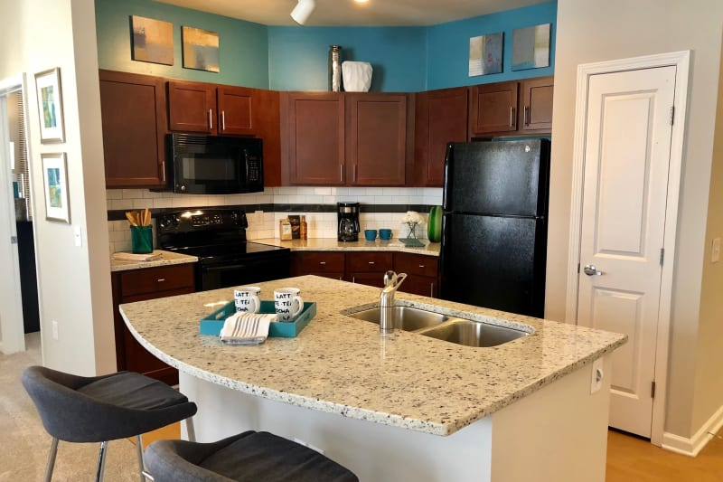 Island in open kitchen at Level at 401 in Raleigh, North Carolina