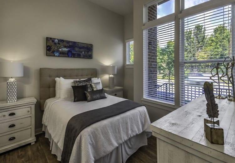 Lovely model bedroom at 300 Optimist Park in Charlotte, North Carolina