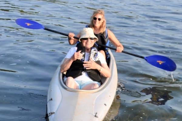 A resident of Ebenezer Ridges Campus gets a kayak tour on Lake Chelan