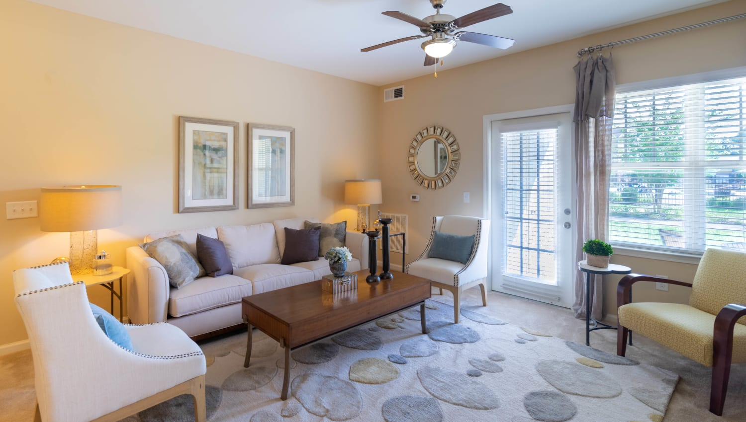 Ceiling fan and modern decor in the living area of a model home at Legends at White Oak in Ooltewah, Tennessee