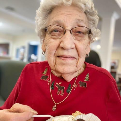 Resident enjoying dessert at Madison House in Norfolk, Nebraska