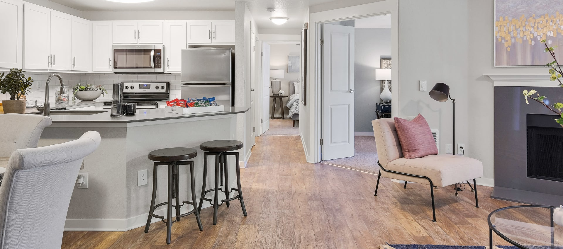 Spacious kitchen and living room at Centro Apartment Homes in Hillsboro, Oregon