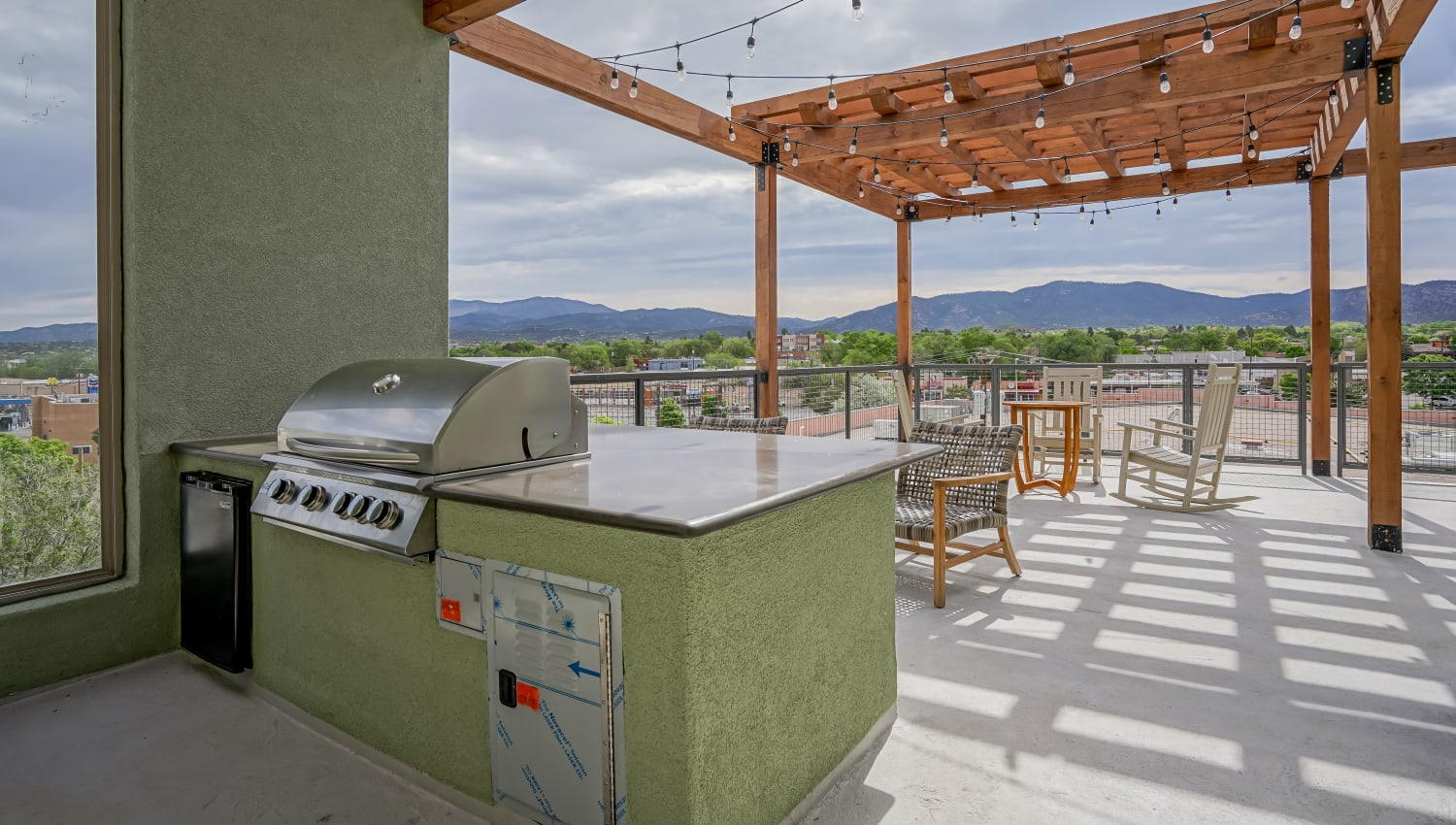 Barbecue on the patio with gorgeous views at Capitol Flats in Santa Fe, New Mexico