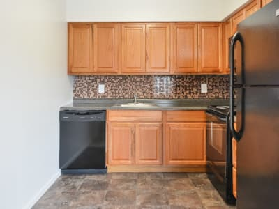 Maple cabinetry on display in the sleek kitchen at William Penn Village Apartment Homes in New Castle, DE