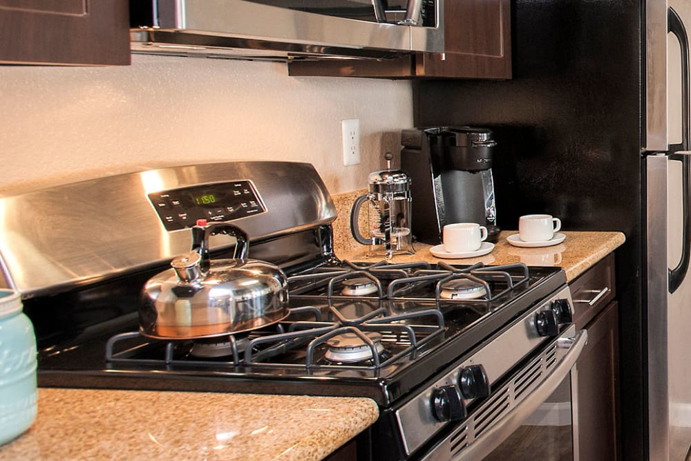 Apartment luxury kitchen with stainless-steel appliances at Deer Valley Apartment Homes in Roseville, California