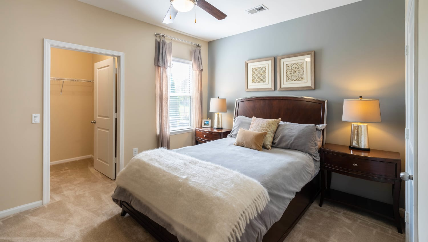 Luxuriously furnished model home's master bedroom with a large walk-in closet at Legends at White Oak in Ooltewah, Tennessee