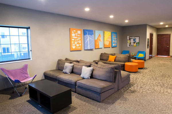 The clubhouse with seating and a TV at Campus View & Kirkwood Court in Cedar Rapids, Iowa