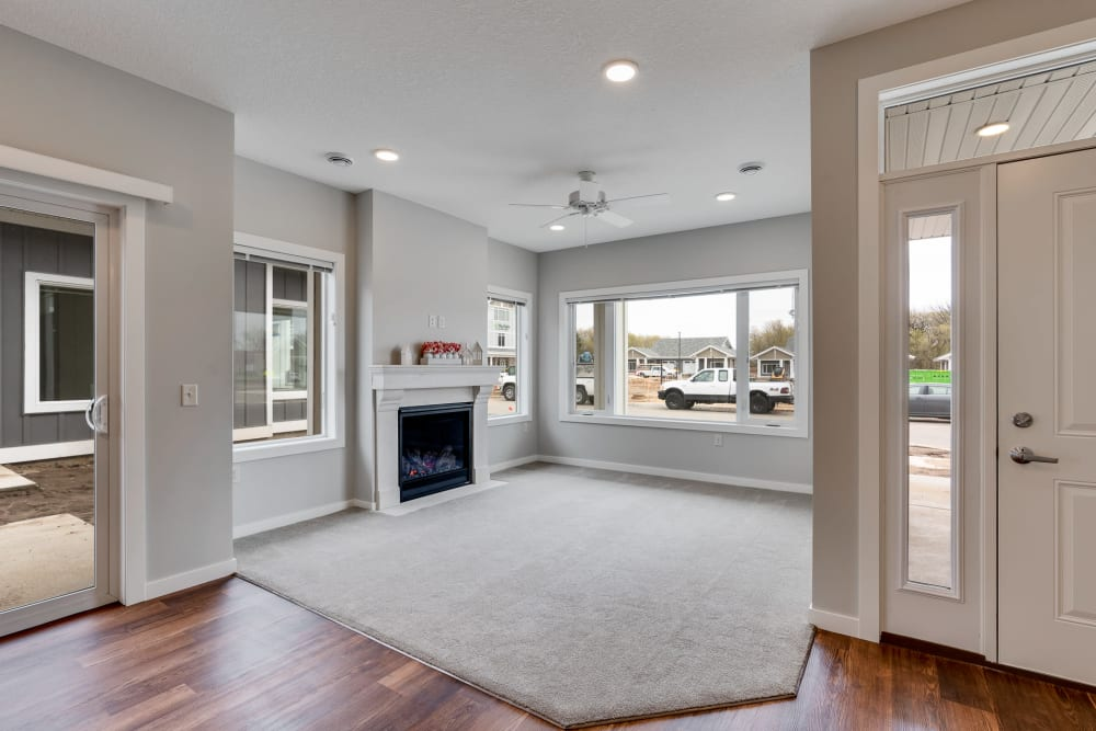 Open living room with fireplace at The Fields at Arbor Glen in Lake Elmo, Minnesota