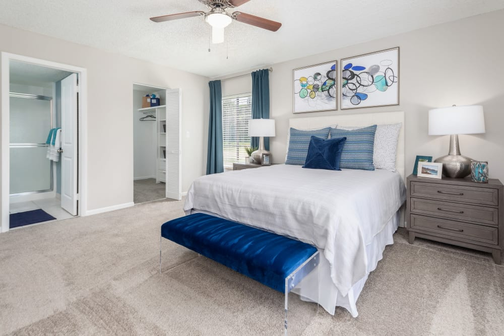 Well-decorated bedroom in model home at Verse at Royal Palm Beach in Royal Palm Beach, Florida