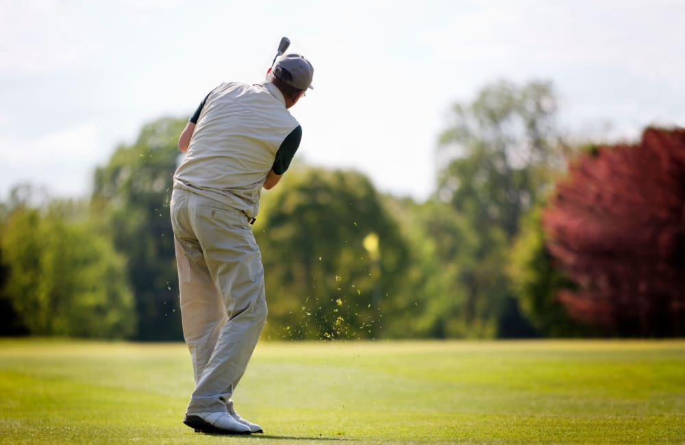 Resident playing golf at a golf course in Sacramento, California near Campus Commons Senior Living