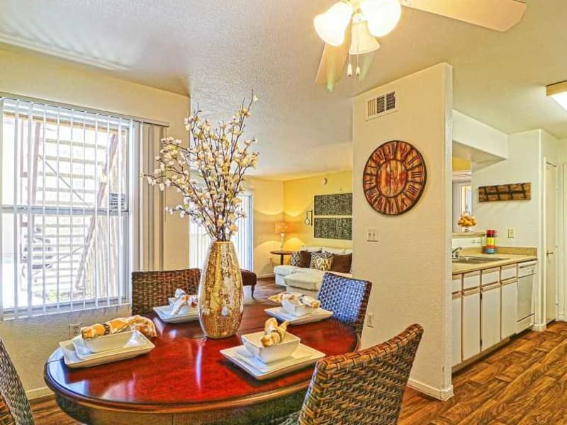 A dining area and kitchen at Monterra Apartment Homes