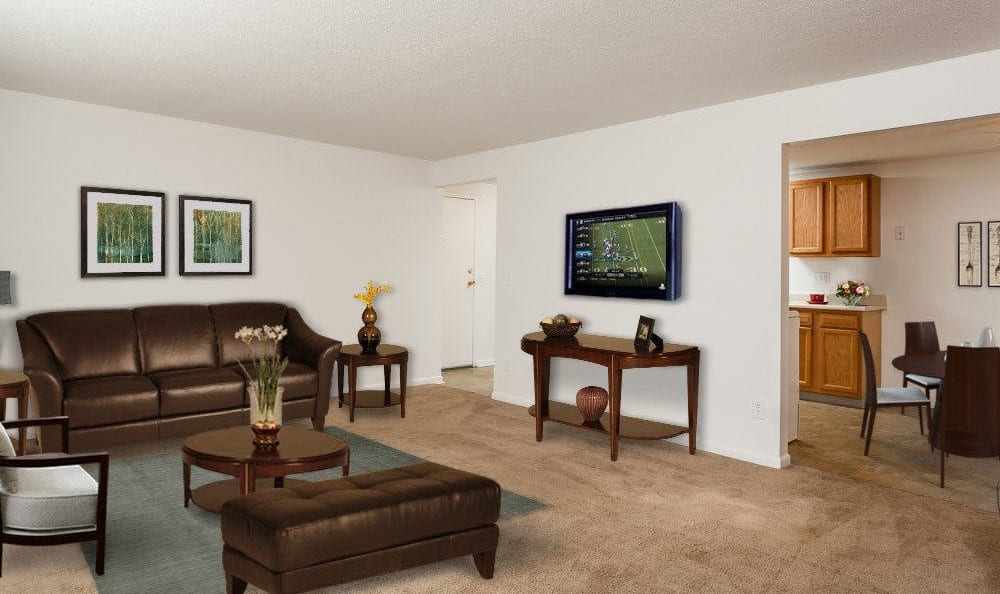 Spacious living room at King's Court Manor Apartments in Rochester, NY