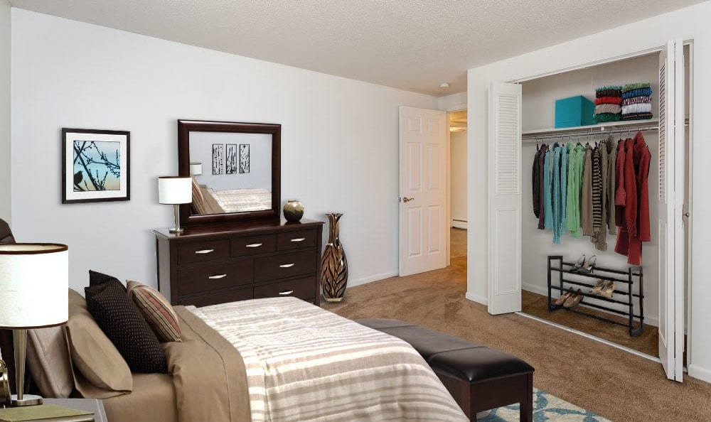 Cozy bedroom at King's Court Manor Apartments in Rochester, NY