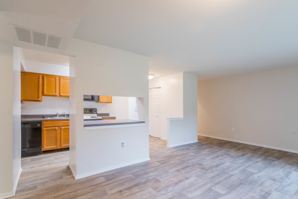 Living room and kitchen at Tamarron Apartment Homes in Olney, Maryland