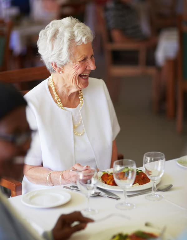 Resident enjoying dinner at The Retreat at Berryville