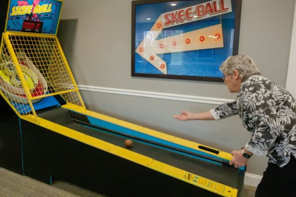 A resident playing skee-ball at Mercer Hill at Doylestown in Doylestown, Pennsylvania