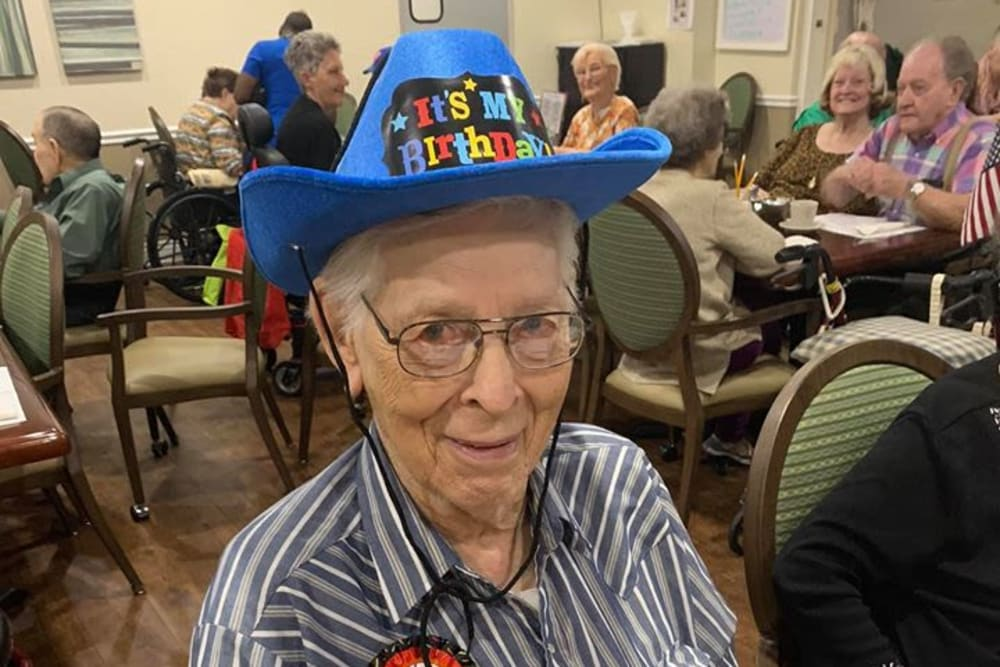 A resident with a fun hat on at Lake Morton Plaza in Lakeland, Florida