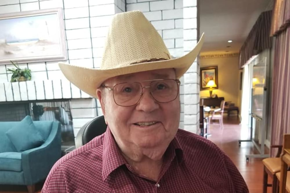 A resident with a cowboy hat on at Legacy Oaks of Sacramento in Sacramento, California